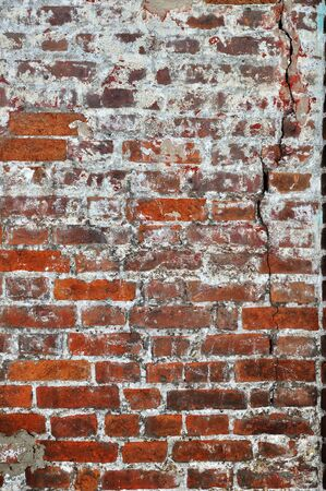 Old red bricks cracked wall background Stock Photo - 13229925