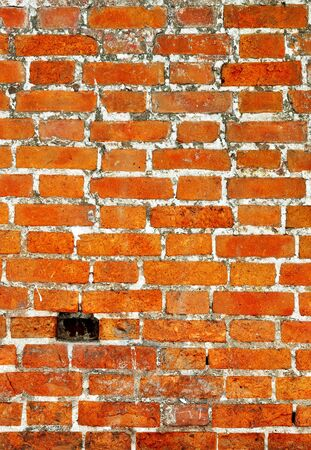 Old red bricks weathered wall vintage background Stock Photo - 13604827