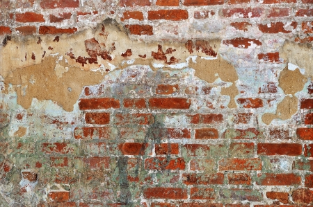 Old red bricks weathered damaged wall background Stock Photo