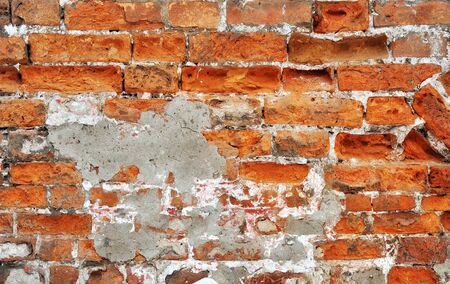 Old red bricks weathered damaged wall background Stock Photo - 13704036