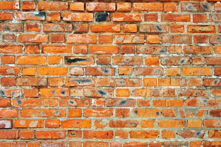 Old red bricks weathered wall background Stock Photo - 13704031