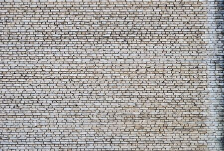 Old gray bricks weathered wall vintage background Stock Photo - 13704037