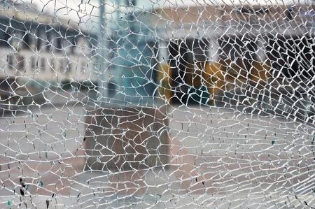 Cracked broken destroyed glass damaged window background Stock Photo