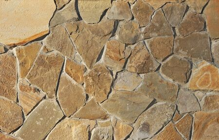 Old weathered stone tiles wall vintage background photo