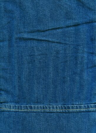 Stitched textured blue denim fabric jeans background photo