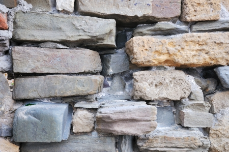 Old weathered damaged stone blocks wall vintage background photo
