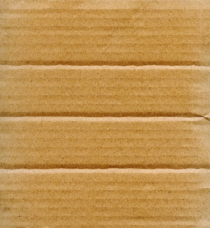 Textured recycled cardboard with natural fiber parts Stock Photo - 13765102