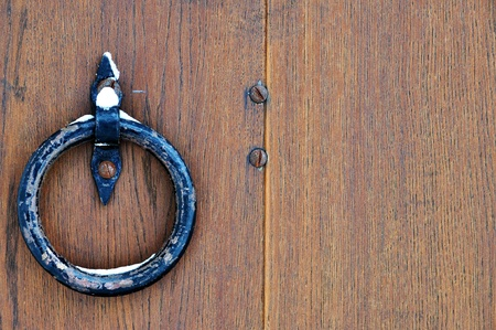 Closeup image of old door with circle iron doorhandle Stock Photo - 13766096