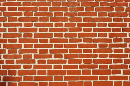 Weathered aged red brickwork wall vintage background