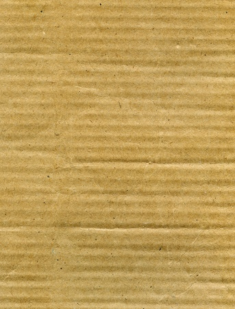 Textured recycled cardboard with natural fiber parts Stock Photo - 13784116