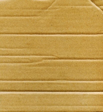 Textured recycled cardboard with natural fiber parts Stock Photo - 13823926