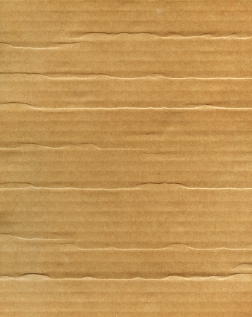recycled paper: Textured recycled cardboard with natural fiber parts Stock Photo