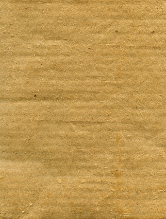 Textured recycled rough cardboard with natural fiber parts Stock Photo - 13842859