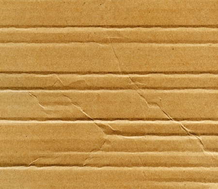 Textured recycled cardboard with natural fiber parts Stock Photo - 13852403