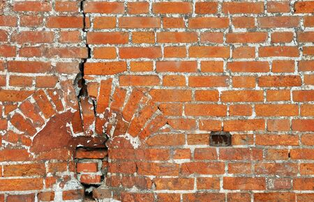 Ancient red bricks cracked wall background Stock Photo - 13855207