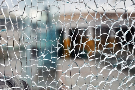 Cracked broken destroyed glass damaged window background Stock Photo
