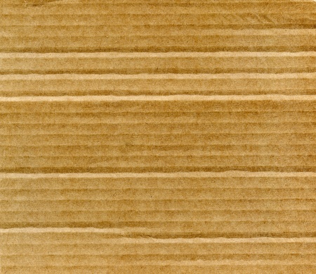Textured recycled cardboard with natural fiber parts Stock Photo - 13868964