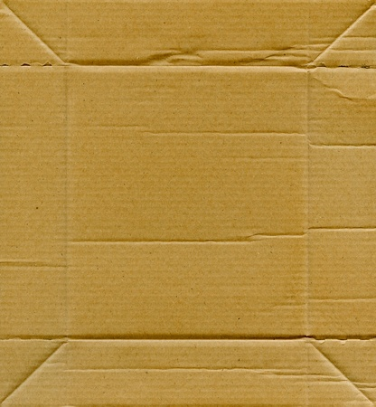 Textured recycled cardboard with natural fiber parts Stock Photo - 13868958