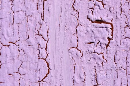 Obsolete weathered cracked lilac painted wood background photo