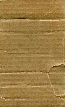 Textured recycled cardboard with natural fiber parts Stock Photo - 14326238