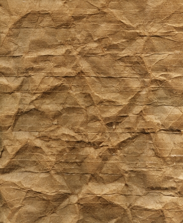 Textured obsolete crumpled packaging brown paper background photo