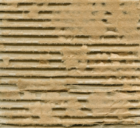 Textured corrugated striped cardboard with natural fiber parts Stock Photo - 14584356