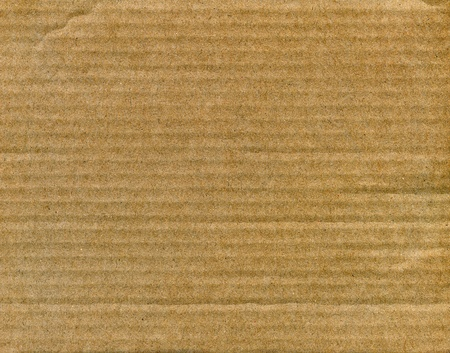 Textured striped recycled cardboard with natural fiber parts photo
