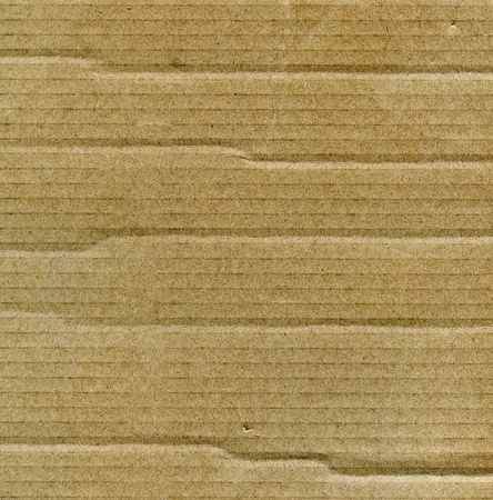 Textured recycled cardboard with natural fiber parts Stock Photo - 15912344