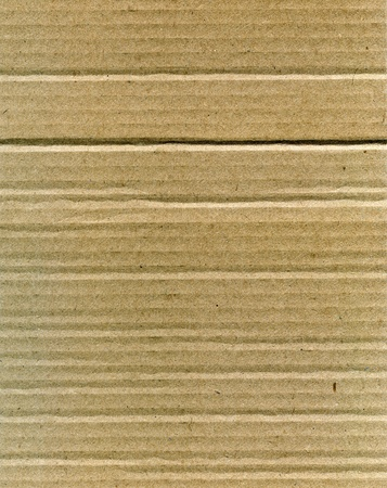 Textured recycled cardboard with natural fiber parts Stock Photo - 16018929