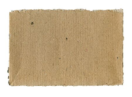 Textured striped rough cardboard with torn edges isolated over white photo