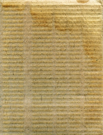Textured aged dirty recycled cardboard with natural fiber parts Stock Photo - 17475226