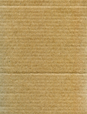 Textured recycled cardboard with natural fiber parts Stock Photo