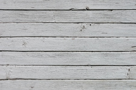 grooved:  Weathered striped textured wooden planks background
