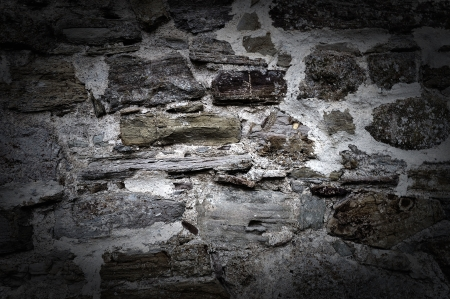Weathered antique old cracked stone blocks wall vintage background