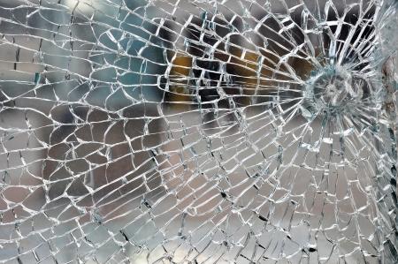 bullet hole: Cracked broken destroyed glass damaged window background Stock Photo