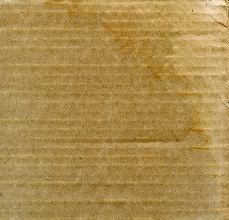 Textured recycled weathered old cardboard with natural fiber parts photo