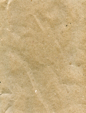 Textured obsolete crumpled packaging brown paper  photo