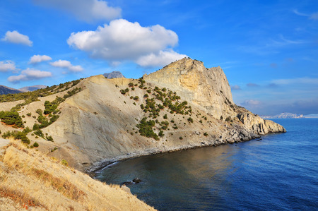 Small rocky sea bay and beautiful sky, wonderful sunny day photo
