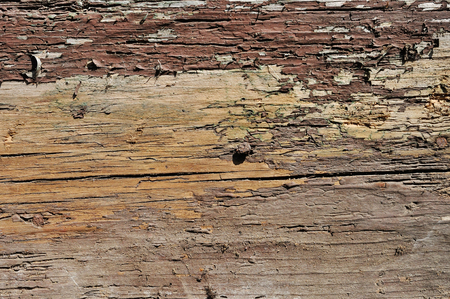 painted wood: Obsolete weathered cracked brown painted wood background Stock Photo