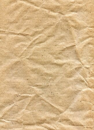 textured paper background: Textured obsolete crumpled packaging brown paper background