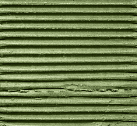 Obsolete textured recycled green cardboard with natural fiber parts Stock Photo