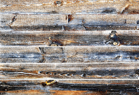 Weathered striped textured wooden planks panel background