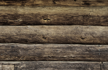 residential: Weathered wooden logs wall of rural house background Stock Photo