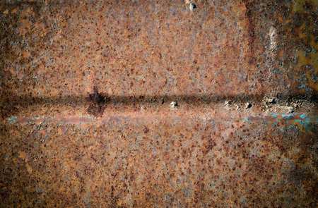 Obsolete corroded textured rusty metal surface background