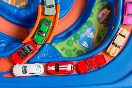 Many scale model toy cars accident on the road. Traffic jam. Stupidity. Top view.