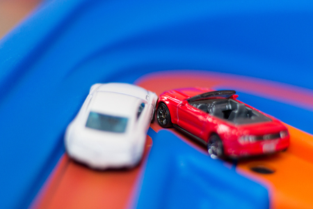 Model toy cars accident on the road. Traffic jam. Stupidity.
