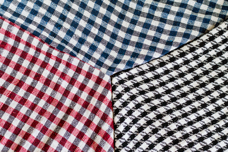 Three wool scarfs. The keffiyeh is a black, red or blue and white scarf that is usually worn around neck or head