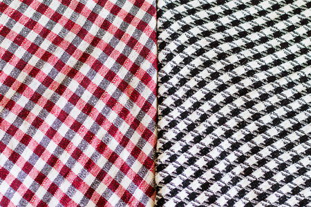 Two wool scarfs. The keffiyeh is a black, red or blue and white scarf that is usually worn around neck or head