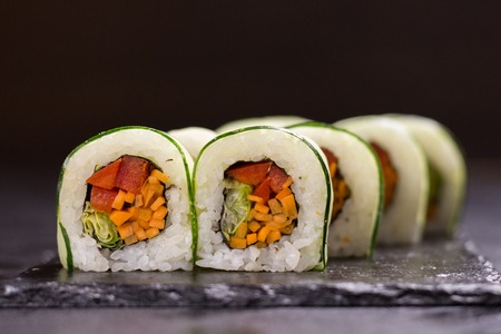 Vegetarian roll with cream cheese, sesameand carrot. Japanese food Stock Photo