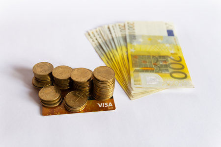 Coins, credit card and euro banknotes cash isolated on white